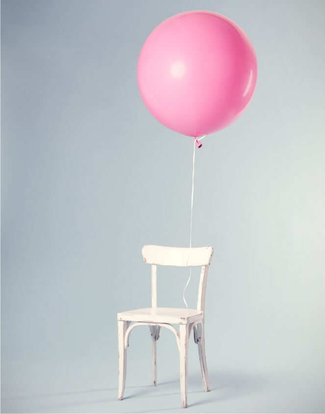 LEP pink balloon floating on chair
